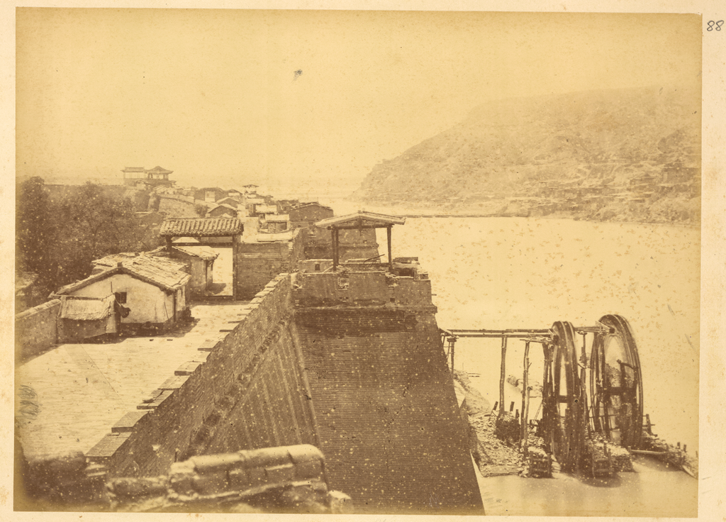 Water-Lifting_Wheel_on_the_Huang_He_(Yellow_River),_Northern_Part_of_City_Wall_of_Lanzhou,_Gansu_Province,_China,_1875_WDL2076